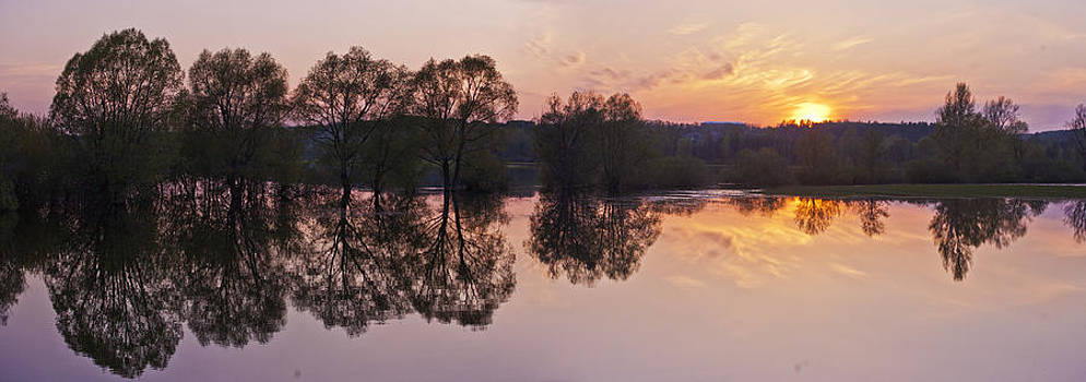 Sunset over the spring flood by Andrew Shlykoff