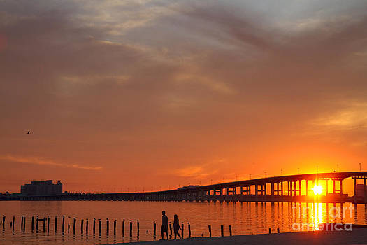 David R Frazier and Photo Researchers  - The Biloxi Bay Bridge at Sunset