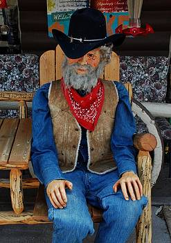 The old man - wooden statue by Dany Lison