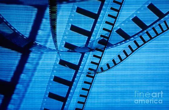 Sami Sarkis - Transparent roll of 35mm movie film displayed on tv screen