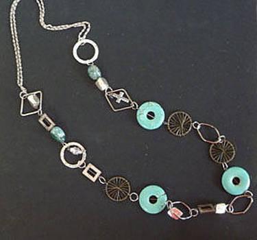 Turquoise Doughnuts W. Silver Rings by Joan  Jones