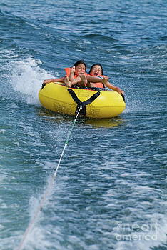 Sami Sarkis - Two children on inflatable ring