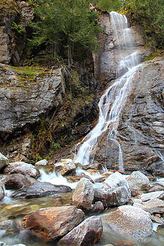 Waterfall On Rock Face by Wyatt Rivard