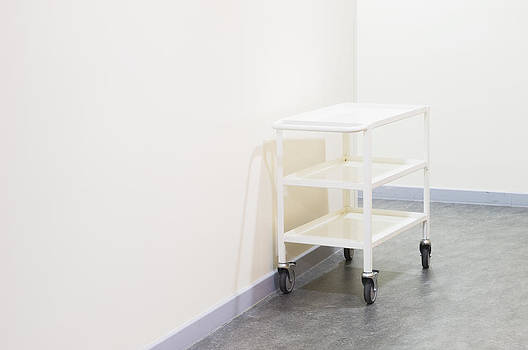 White Trolley Against A Wall by Iain  Sarjeant