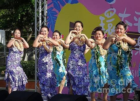 Female Dancers Perform a Hawaiian Dance by Yali Shi
