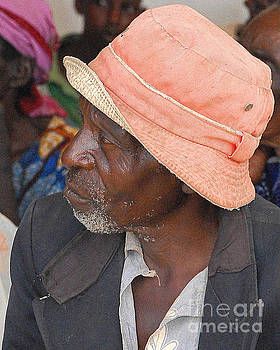 Man in Pink Hat by Robert  Suggs