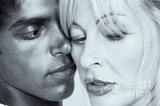 Older caucasian woman making out with younger man by Amyn Nasser