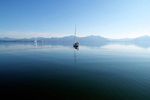 Sailing boats in Chiemsee lake in Germany by Jirawat Cheepsumol