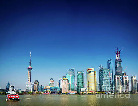 Shanghai Pudong Skyline And Local River Ferry In China by Jacek Malipan