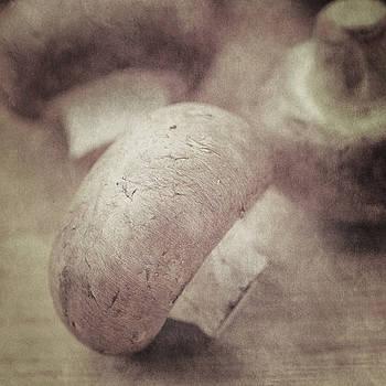 Still life of chestnut mushrooms by Lars Hallstrom