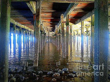 Under The Boardwalk - Walton On The Naze Pier by J J  Everson