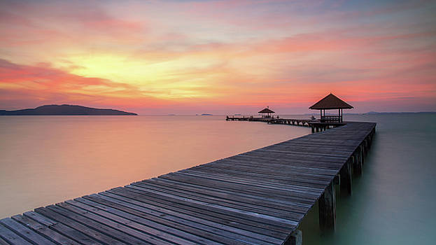 Wooden pier between sunset in Phuket by Anek Suwannaphoom