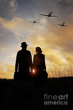 1940s Couple At Sunset With Spitfire Airplanes by Lee Avison