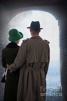1940s Couple Standing Underneath A Stone Archway by Lee Avison
