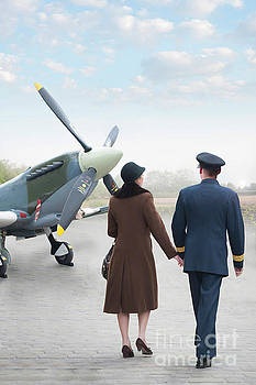 1940s Couple Walking Towards A Supermarine Spitfire by Lee Avison