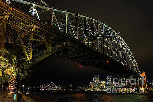 Sydney Harbour Bridge And Skyline Landmarks In Australia At Nigh by Jacek Malipan