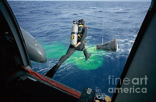 R Muirhead Art - A Navy frogman leaps from recovery helicopter into water to assist the Gemini 12 recovery operations