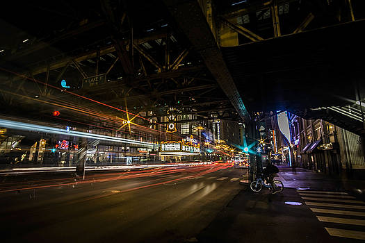 a nighttime look at Chicago's busy State and Lake Intersection by Sven Brogren