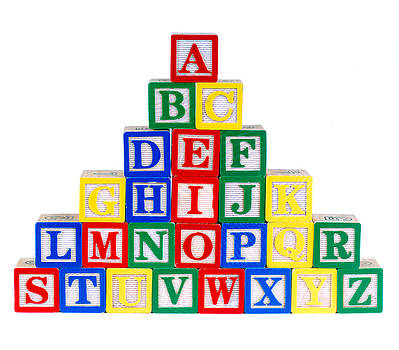 A Pyramid Of Alphabet Toy Bricks by Norman Pogson