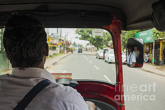 Patricia Hofmeester - A tuk tuk driver on the road