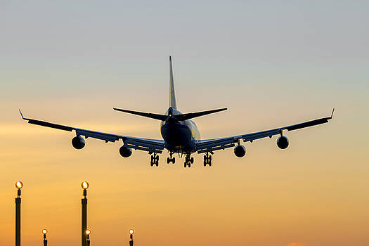 Aircraft Landing at Sunset by Derek Beattie
