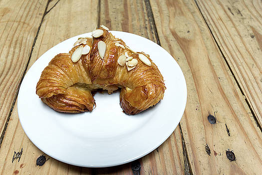 Almond Croissant on a White Plate by Jit Lim