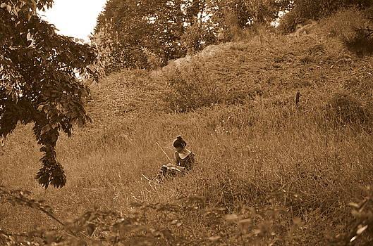Alone With A Book by Riad Belhimer