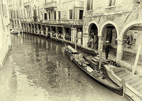 Along a busy canal in Venice by John Hoey