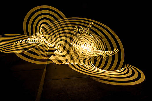 AN abstract yellow ribbon of painted light by Sven Brogren