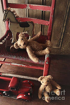Sandra Cunningham - Antique toys on red wooden chair