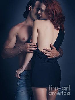 Artistic sensual portrait of a couple embracing by Oleksiy Maksymenko