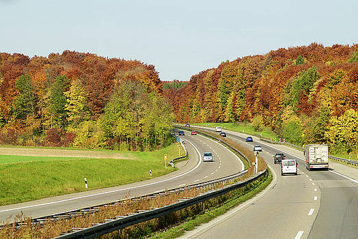 Autumn color highway by Jirawat Cheepsumol