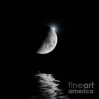 Backlit moon with white star over water by Simon Bratt Photography LRPS