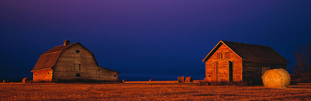 Barns at night by David Nunuk