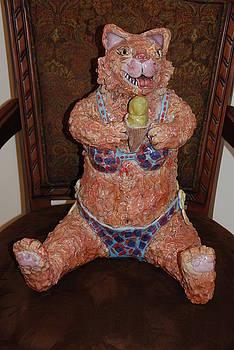 Bear Bear at thebeach licking a pistachio ice cream cone by Vicki McComas