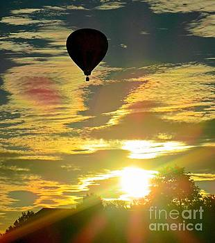 Beautiful Flaring Sunrise with Hot Air Balloon Silhouette by John Malone
