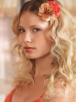 Beauty portrait of a woman with floral hairpiece in blond hair by Oleksiy Maksymenko