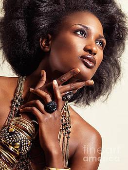 Beauty portrait of african american woman wearing jewelry by Oleksiy Maksymenko