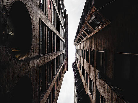 Between buildings in Saint Louis by Dylan Murphy