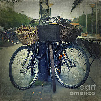 Bicycles with straw basket by Isabel Poulin
