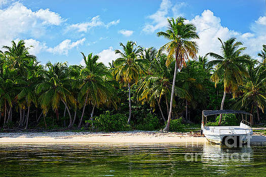 Boat anchored near Bavaro Beach by Eyzen M Kim