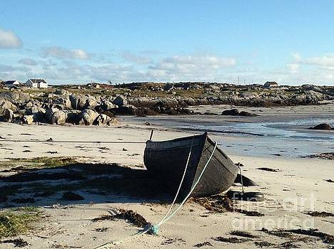 Boat on beach by Maureen Dowd