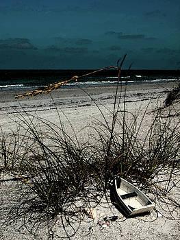 Boat on the beach by Randy Sylvia