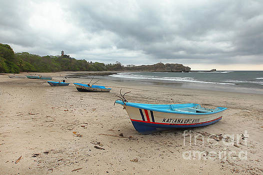 Boats at the beach in Costa Rica by Juan Carlos Vindas