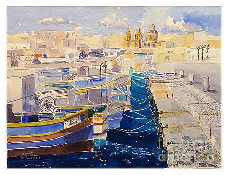 boats berthed at Marsaxlokk by Godwin Cassar
