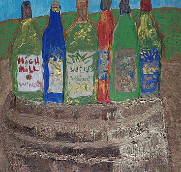 Bottles Of Wine On Wooded Barrel by Maggie Cruser
