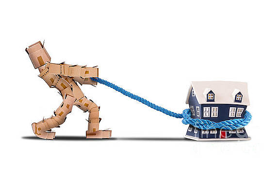 Box character pulling a house with a rope by Simon Bratt Photography LRPS