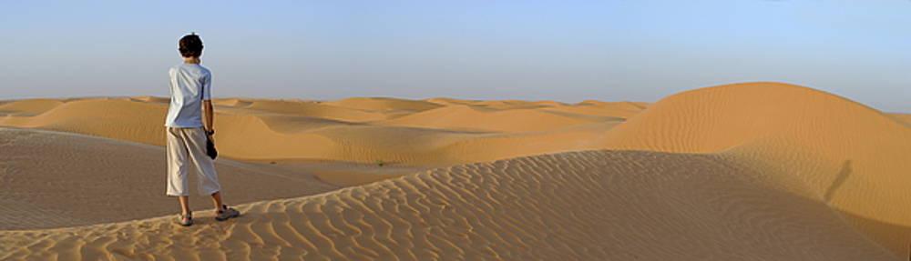 Sami Sarkis - Boy looking at dunes in Sahara Desert