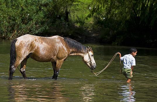 Boy with horse by Kobby Dagan