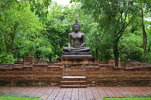 Buddha Statue Among Old Brick Wall by Jirawat Cheepsumol